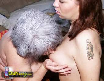 Grey hair woman sucking young girl's nipples
