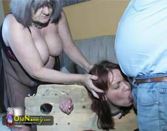 Making her slave suck on cock