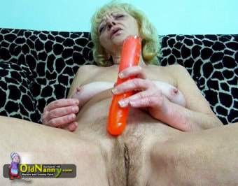 Blonde grandma using her toy on couch